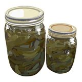 Home canned sweet pickles. Illustration of a quart and a pint jar of home canned sweet pickles Stock Photo