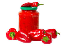Home canned vegetables in jar and peppers Royalty Free Stock Photo
