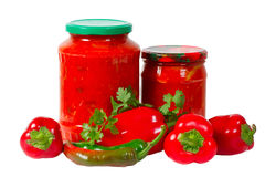 Home canned vegetables in jar and peppers Stock Images