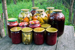 Home canning. Pickled vegetables and jam royalty free stock photography