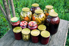 Home canning. Pickled vegetables and jam royalty free stock photos