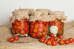 Home canning. Banks pickled tomatoes Royalty Free Stock Images