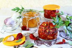 Home canning. Pepper. Marinated hot chili with spices in jars. stock photos