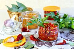 Home canning. Pepper. Marinated hot chili with spices in jars. stock photo
