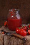 Home canning of tomato paste Stock Photos