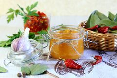 Home canning. Vegetable puree. Cabbage caviar with spices, pepper and garlic in a jar. royalty free stock photos