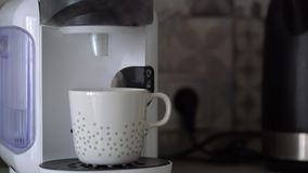Home capsule coffee machine prepares a cup of fresh coffee. Cloud of steam at the end of cooking. Home capsule coffee machine prepares a cup of fresh coffee stock video footage