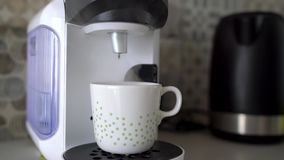 Home capsule coffee machine prepares a cup of fresh coffee. Cloud of steam at the end of cooking. Home capsule coffee machine prepares a cup of fresh coffee stock footage