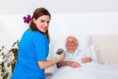 Home care - blood pressure measuring Stock Images