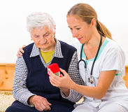 Home care. Photo of a miniature house holding in hands stock photo