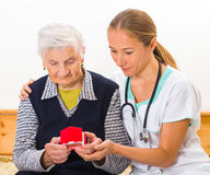 Home care. Photo of a miniature house holding in hands stock image
