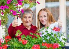 Home care. Thumbs up because everything is all right royalty free stock photography
