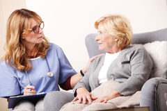 Home caregiver and senior patient Royalty Free Stock Photo