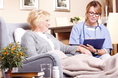 Home caregiver working Stock Images