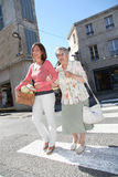 Home carer with elderly person in town Royalty Free Stock Photography
