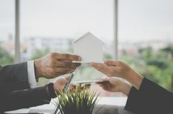 Home for cash for home loan and buying concept. Trading home for cash for home loan and buying concept royalty free stock images