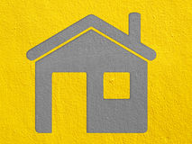 Home on cement wall Stock Images