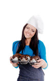 Home Chef. Beautiful home chef holding a tray of cup cakes/ muffins Stock Image