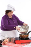 Home chef at work. Woman busy cooking in the kitchen Stock Images