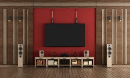 Home cinema in classic style. Home cinema room with TV hanging on the wall and wooden decorations - 3d rendering Royalty Free Stock Images
