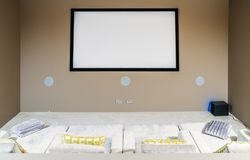 Home cinema with comfortable sofa couches in luxury home.  royalty free stock images