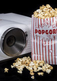 Home Cinema Equipment. Home Cinema projector with fresh made Popcorn Royalty Free Stock Photography