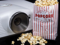 Home Cinema. Projector with fresh made Popcorn royalty free stock photos
