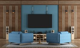 Home cinema room with TV hanging on blue wall. Armchairs and wooden decorations - 3d rendering Royalty Free Stock Photos