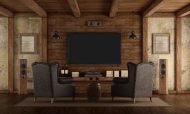 Home cinema in rustic style. With two leather classic armchairs ,old wall and wooden beams - 3d rendering Stock Image