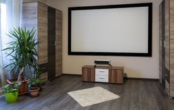 Home Cinema System with projector. Home Cinema System with ultra short throw laser projector, visual relaxing royalty free stock image