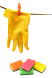 Home cleaning equipement. Set of household equipement - protective glove and colorful cleaning sponges Royalty Free Stock Photos