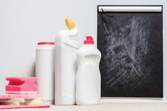 Home cleanup cleaning supplies set rating mockup. Home cleanup. Quality cleaning supplies set. Opinion and rating blackboard mockup stock photography