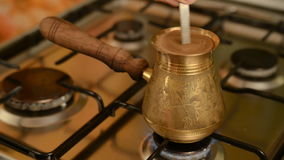 The home coffee in stove. Freshly ground coffee is brewed on the stove. It is stirred with a spoon stock video