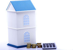 Home with coin and calculator Royalty Free Stock Photos
