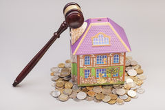 Home, coins and gavel.Real estate concept Stock Images
