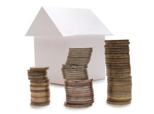 Home and coins Royalty Free Stock Image