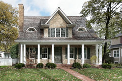 Home with columns. Brick and shingled roof Stock Photography