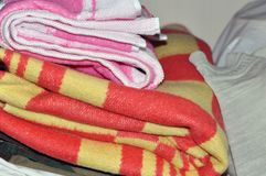 Storage of clothes and linen in the home closet. Home and comfort. storage of clothes and linen in the home closet stock image
