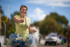 Home coming parade person handing out candy Stock Photo