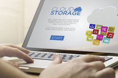 Home computing cloud storage. Cloud information concept: man using a laptop with digital drive storage website on the screen. Screen graphics are made up Royalty Free Stock Photos