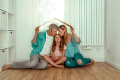 Home concept. Family dreaming of new home stock photo