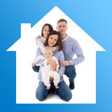 Home concept - father, mother, daughter and son in blue house stock photos