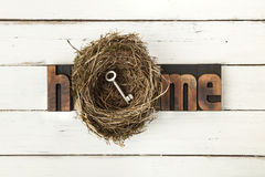 Home Concept with key in nest Stock Image