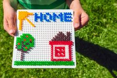 Home concept made from beads stock images