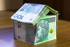 Home concept made from hundred zloty. Banknotes Stock Photo