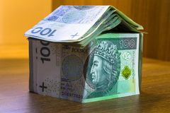 Home concept made from hundred zloty. Banknotes Stock Photos