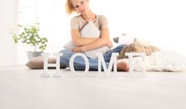 Home concepts, young woman hugging a big comfortable cushions, s stock image