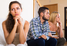 Home conflict among three young adults Royalty Free Stock Photography