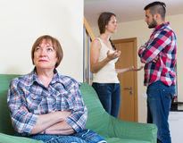 Home conflict at young family with mother Stock Photography