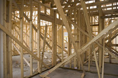 Home construction 1. Looking inside a house under construction. Framing elements Royalty Free Stock Images